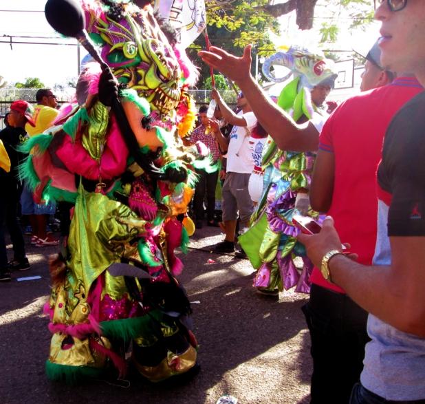 A patron in the crowd negotiates his way out of a vejigaso. Photo by José Germosén